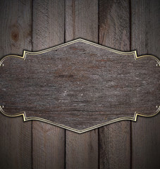 wood background with wooden name plate with gold trim
