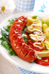 grilled sausage,vegetable salad and potato