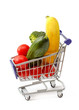 Mixed fruit and vegetables in a mini shopping cart, isolated on
