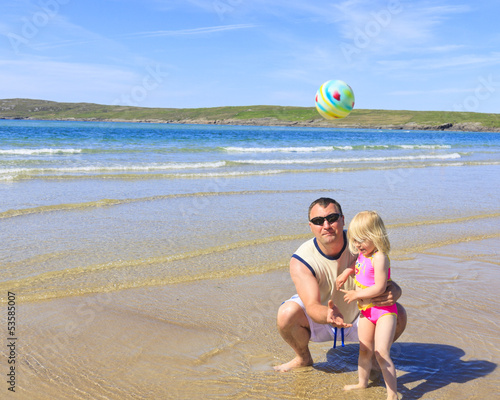 canvas print picture Dad playing in ball with his daughter.