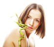 Spa beauty - woman with green bamboo in hands