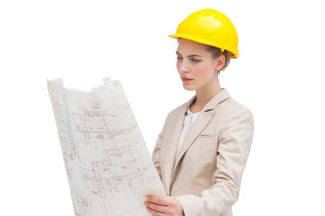 Pretty architect examining construction plan
