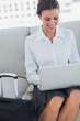 Happy business woman using laptop