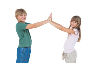 Smiling boy and girl high fiving