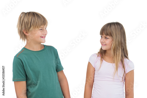 Little girl and boy looking at each other and smiling
