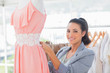 Fashion designer working on dress