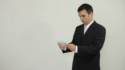 Funny businessman playing game on electronic tablet
