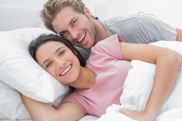 Couple laughing and looking at camera