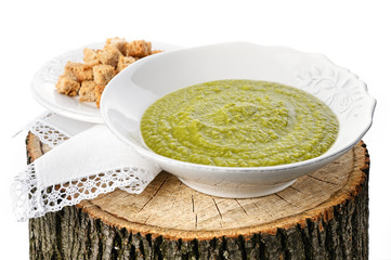 Green pea soup with croutons on the stub