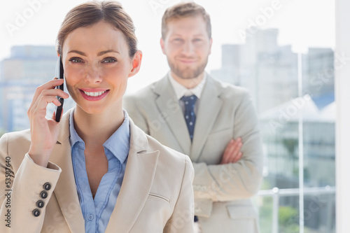 Smiling businesswoman having phone conversation