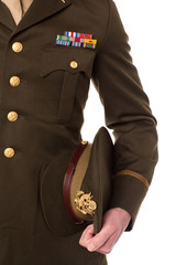 Military personnel holding his precious cap