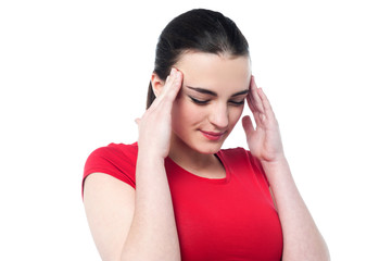 Young girl having serious headache