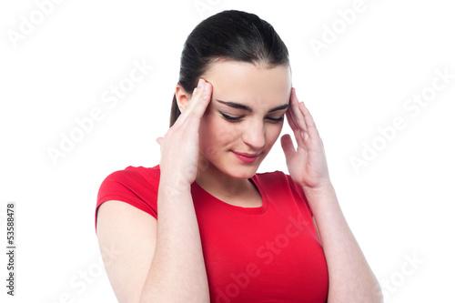 Young girl having serious headache