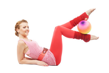Beautiful sporty woman working out with aerobic ball