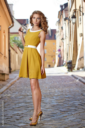Young fashion woman in old city
