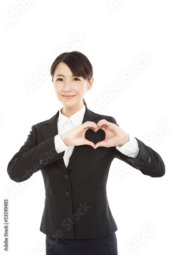 young businesswoman showing heart by her hands