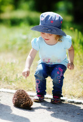 girl and hedgehog