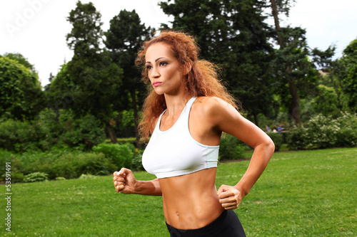 Beautiful middleaged woman working out