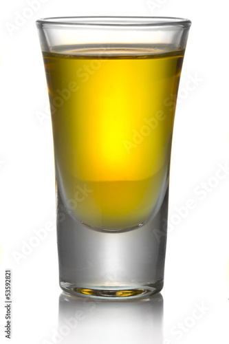Gold transparent tequila shot isolated on white