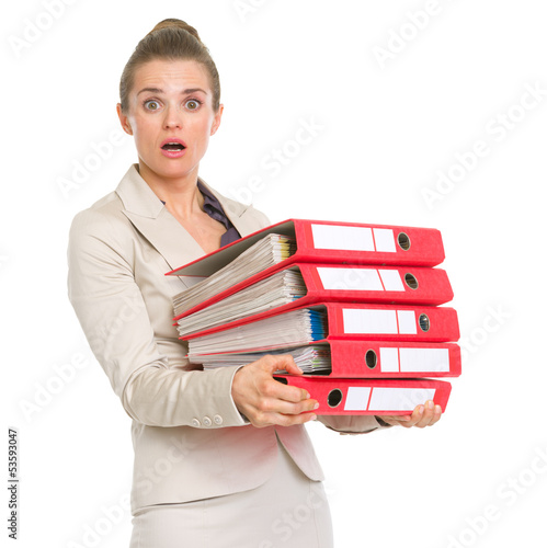 Surprised business woman holding stack of folders