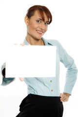 Smiling woman holding blank business card. Focus on face.