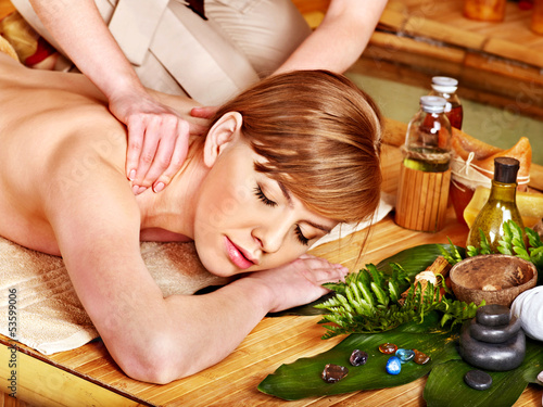 Woman getting aroma massage.