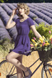 portrait of pretty girl with bicycle . outdoor field lavander