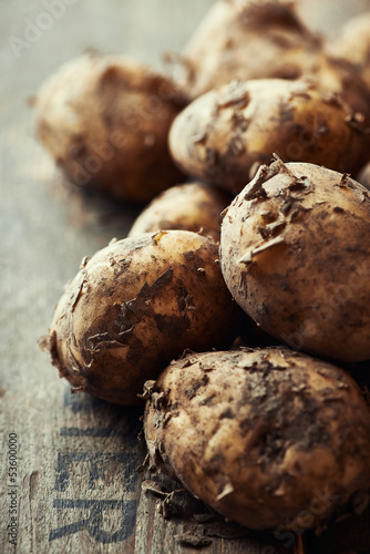 New potatoes on wooden background