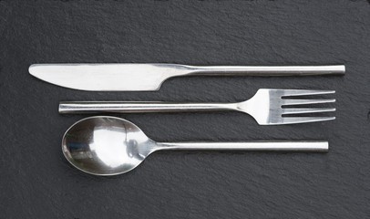 Macro image of cutlery set on rustic background