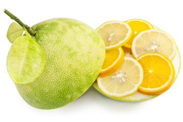 Green pomelo fruit cut with segments of lemon and orange