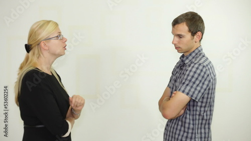 Angry boss businesswoman pointing and yelling at employee