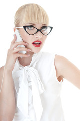 Business executive using smartphone and wearing glasses.