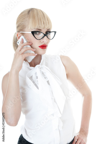 Sexy blonde business executive using smartphone.