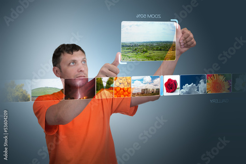 Man looks at photos of the virtual display