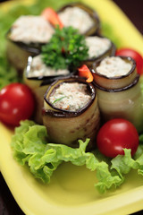 Eggplant and Ricotta cheese rolls served with  cherry tomatoes