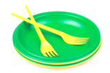 bright green and yellow plastic disposable tableware, plates and