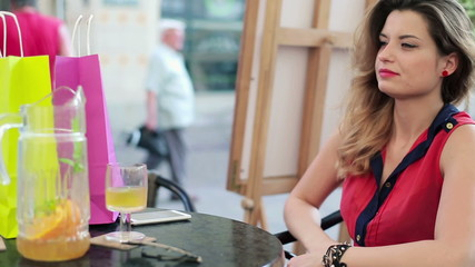 Beautiful woman drinking and relaxing in cafe
