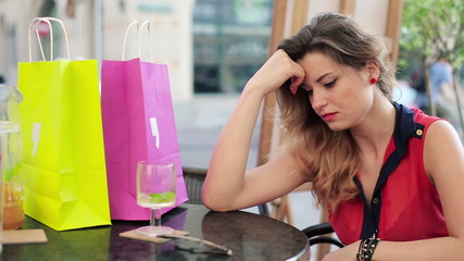 Sad beautiful woman sitting in cafe