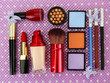 Decorative cosmetics on purple background