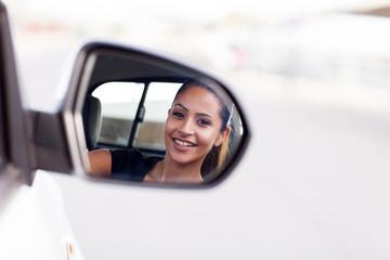 young businesswoman driver looking at side mirror