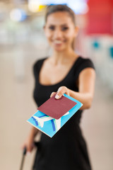 young businesswoman presenting air ticket and passport