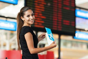 cute businesswoman travelling by air