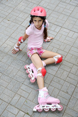 Little girl in roller skates at  park