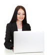 Young business woman working with computer, isolated on white