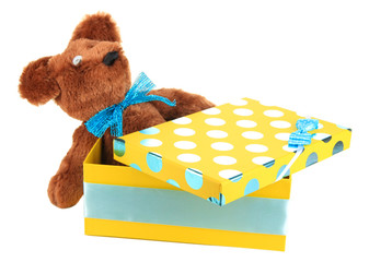 Yellow gift box with toy isolated on white