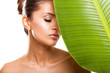 beautiful woman face with green leaf