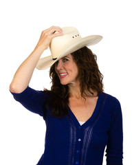 Attractive middle aged cowgirl in a white hat
