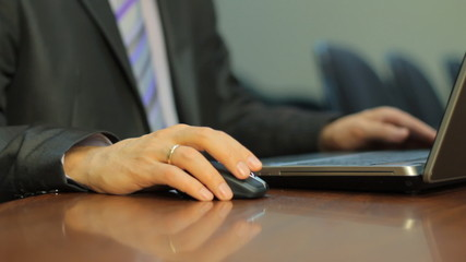 Hand of  Businessman moving a computer mouse