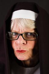 Stern Nun
