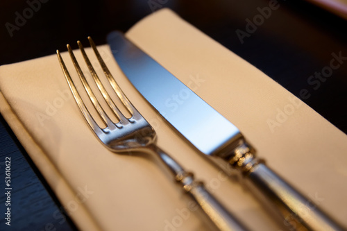 Fork, knife and napkin on restaurant table